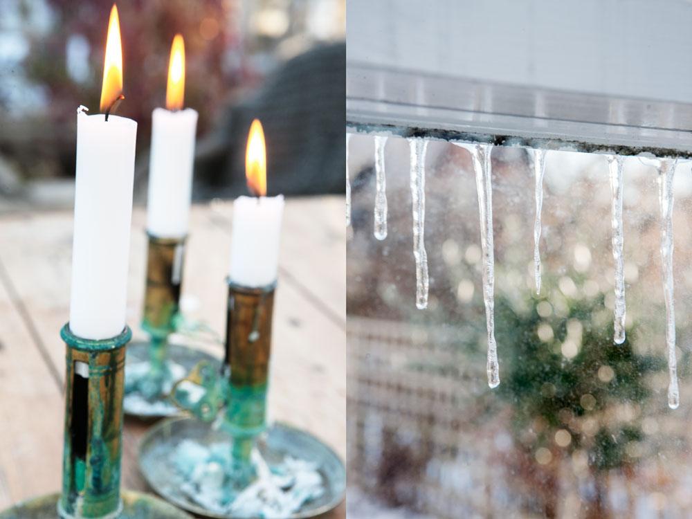 Tända stearinljus i gamla ärrade mässingsljusstakar och istappar utanför växthuset som glittrar i novembersolen