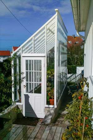 Ett växthus med pulpettak